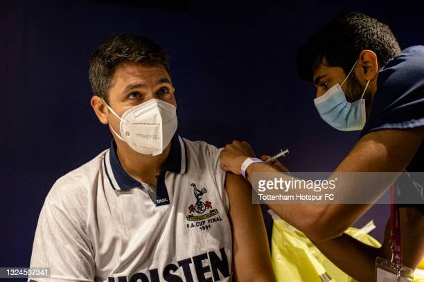 Tottenham Hotspur fan Marcelo receives the Covid-19 vaccine at a walk-in vaccination clinic taking place at the Tottenham Hotspur Stadium on June 20,...