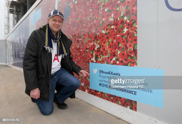 Tottenham Hotspur fan points to his tweet that is displayed on the redevleopment site during The Emirates FA Cup QuarterFinal match between Tottenham...