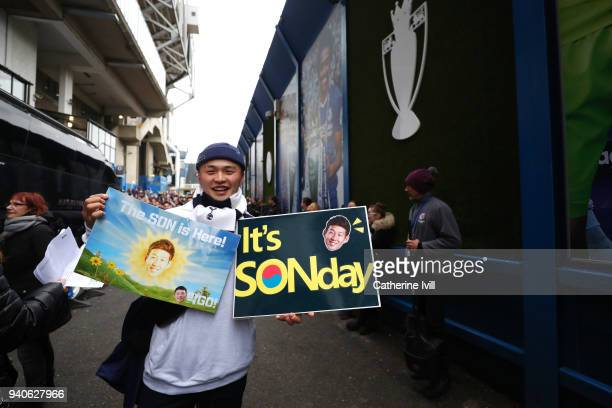 Tottenham Hotspur fan poses for a photo with his HeungMin Son themed posters prior to the Premier League match between Chelsea and Tottenham Hotspur...