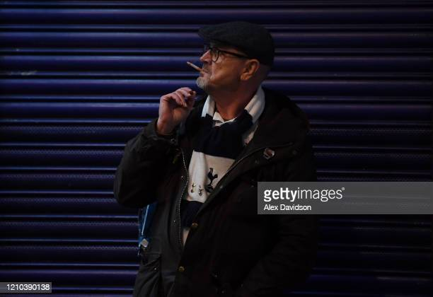 Tottenham Hotspur fan smokes a cigarette before the FA Cup Fifth Round match between Tottenham Hotspur and Norwich City at Tottenham Hotspur Stadium...