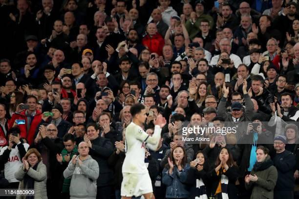 Tottenham Hotspur fans applaud Dele Alli of Tottenham Hotspur during the UEFA Champions League group B match between Tottenham Hotspur and Olympiacos...