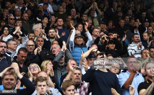 Tottenham Hotspur fans celebrate during the Premier League match between Huddersfield Town and Tottenham Hotspur at John Smith's Stadium on September...