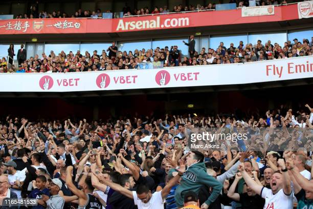 Tottenham Hotspur fans celebrate their 2nd goal as dejected Arsenal fans look on from above during the Premier League match between Arsenal FC and...