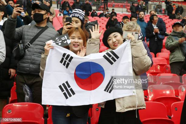 Tottenham Hotspur fans hold up a South Korea flag ahead of the Premier League match between Tottenham Hotspur and Leicester City at Wembley Stadium...