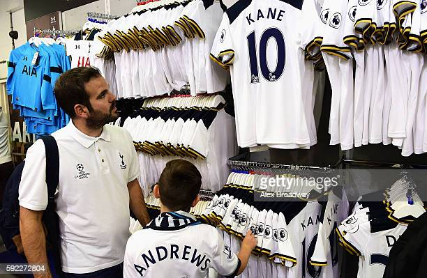 Tottenham Hotspur fans look at Harry Kane of Tottenham Hotspur shirt in the club shop during the Premier League match between Tottenham Hotspur and...