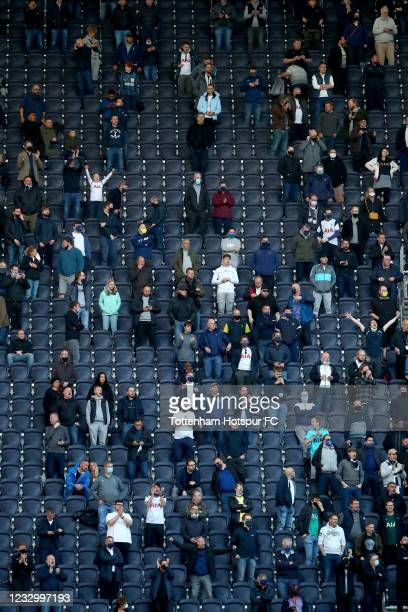 Tottenham Hotspur fans look on during the Premier League match between Tottenham Hotspur and Aston Villa at Tottenham Hotspur Stadium on May 19, 2021...