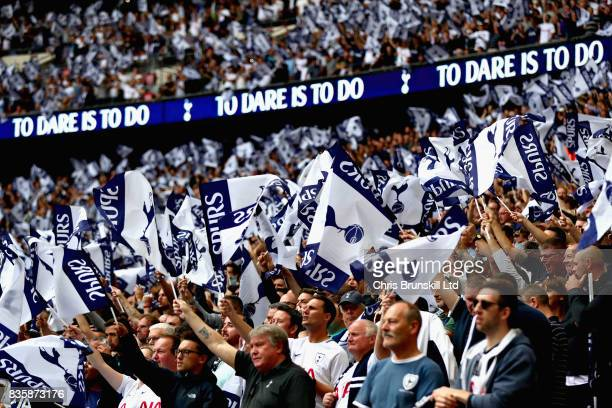 Tottenham Hotspur fans wave club flags during the Premier League match between Tottenham Hotspur and Chelsea at Wembley Stadium on August 20 2017 in...
