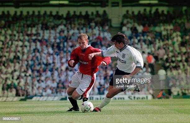 Tottenham Hotspur FC play Manchester United FC in the FA Carling Premiership at White Hart Lane London 10th August 1997 Justin Edinburgh of Spurs and...