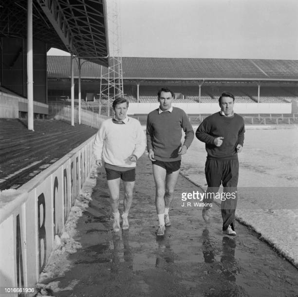 Tottenham Hotspur FC soccer players Alan Mullery Alan Gilzean Jimmy Greaves in training UK 24th January 1965