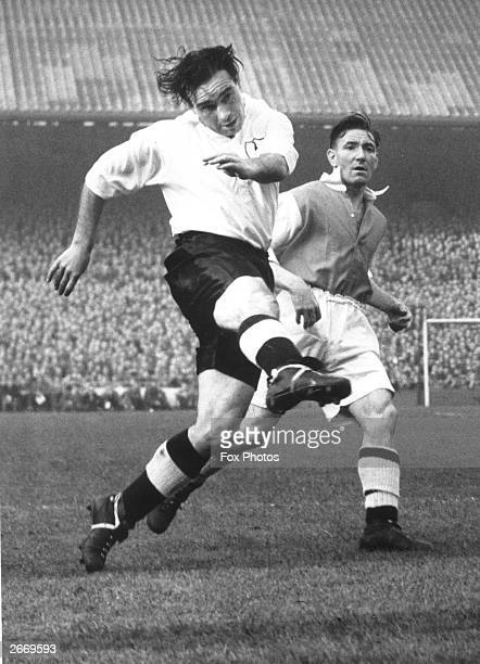 Tottenham Hotspur Football Club player Alf Ramsey in action in a London derby match as Tottenham play Arsenal at White Hart Lane