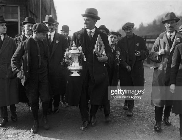 Tottenham Hotspur footballer Arthur Grimsdell with the FA Cup after Spurs had beaten Wolverhampton Wanderers 10 in the final at Stamford Bridge 23rd...
