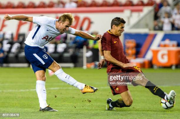 Tottenham Hotspur forward Harry Kane takes a shot and is defended by r25 during the second half of the International Champions Cup between Tottenham...