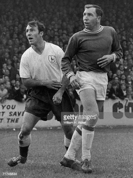 Tottenham Hotspur forward Jimmy Greaves on the field with Leyton Orient midfielder Mal Lucas, 29th October 1962.