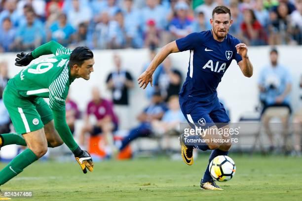Tottenham Hotspur forward Vincent Janssen runs for the ball against Manchester City goalie Arijanet Muric during the International Champions Cup 2017...