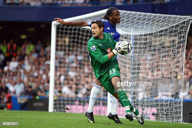 Tottenham Hotspur goalkeeper Carlo Cudicini makes a save in front of Didier Drogba of Chelsea during the Barclays Premier League match between...