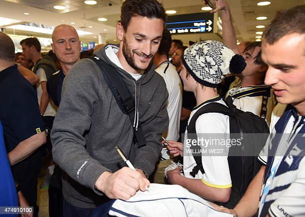 Tottenham Hotspur goalkeeper Frenchman Hugo Lloris signs autographs for fans as he is escorted through Sydney Airport on May 28 as the English...