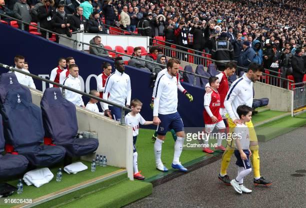 Tottenham Hotspur goalkeeper Hugo Lloris and Harry Kane of Tottenham Hotspur walk out with the team before the Premier League match between Tottenham...
