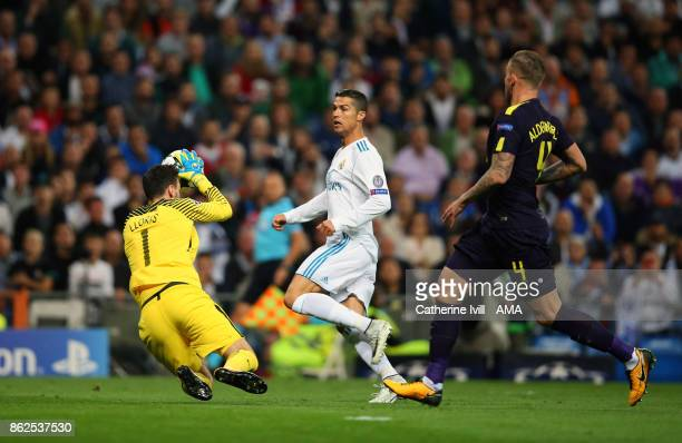 Tottenham Hotspur goalkeeper Hugo Lloris makes a save from Cristiano Ronaldo of Real Madrid during the UEFA Champions League group H match between...