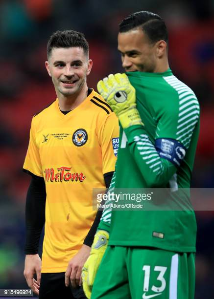 Tottenham Hotspur goalkeeper Michel Vorm with Padraig Amond of Newport County during the FA Cup Fourth Round replay between Tottenham Hotspur and...