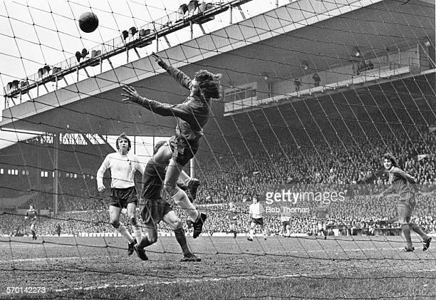 Tottenham Hotspur goalkeeper Pat Jennings acrobatically saves a shot during a game against Liverpool at Anfield Liverpool March 31st 1973