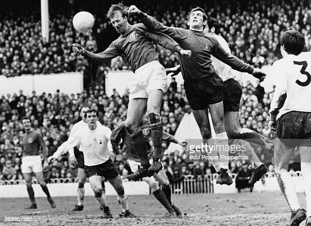 Tottenham Hotspur goalkeeper Pat Jennings punches the ball away from the goal and clear of Leeds United player Jack Charlton during a Tottenham v...