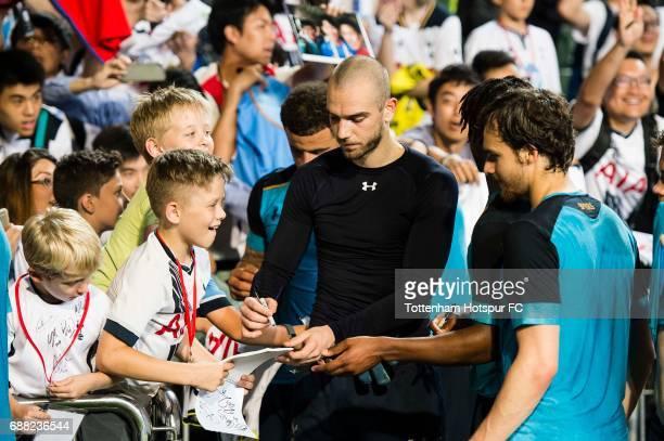 Tottenham Hotspur Goalkeeper Pau Lopez autographs for a fan during a Tottenham Hotspur training session at Hong Kong Stadium on May 25 2017 in So Kon...
