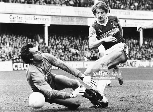 Tottenham Hotspur goalkeeper Ray Clemence dives at the feet of West Ham United's Neil Orr during a First Division match at Upton Park London April...