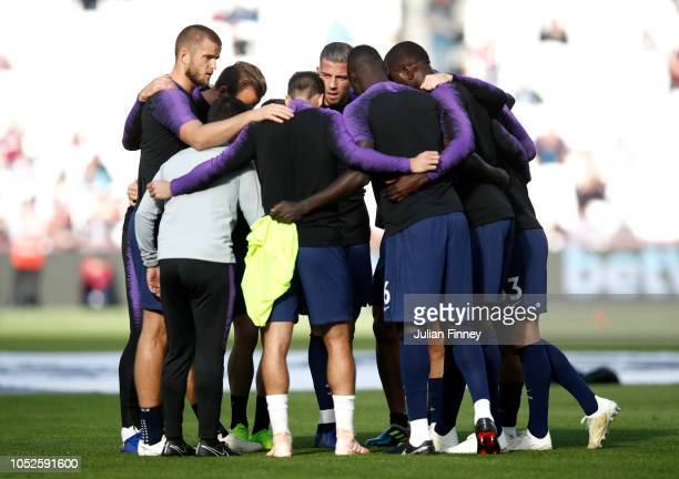 Tottenham Hotspur huddle during warm ups prior to the Premier League match between West Ham United and Tottenham Hotspur at London Stadium on October...