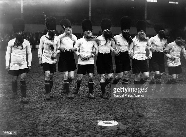 Tottenham Hotspur in hats and false beards as the 'Beavers' for their match against a team of Variety Artists.
