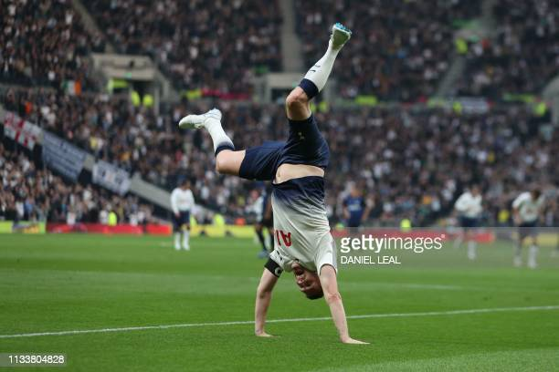 TOPSHOT Tottenham Hotspur Legends' Irish forward Robbie Keane celebrates scoring the second goal during the Legends football match between Tottenham...