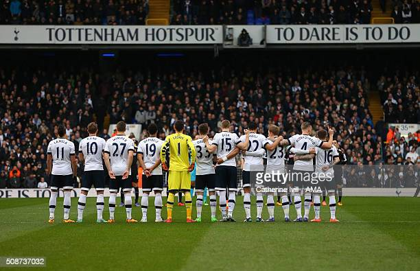 Tottenham Hotspur line up for a minutes applause for late Tottenham Hotspur player Peter Baker before the Barclays Premier League match between...