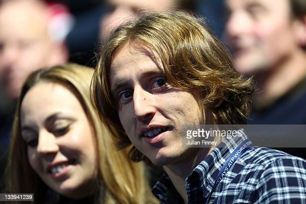 Tottenham Hotspur Luka Modric watches the men's singles match between Roger Federer of Switzerland and Rafael Nadal of Spain during the Barclays ATP...