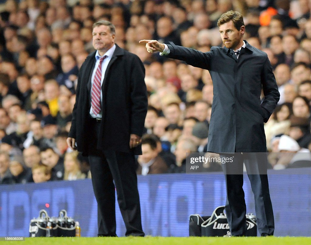 """Tottenham Hotspur manager Andre Villas Boas (R) gestures from the sodeline during the English Premier League football match against West Ham at White Hart Lane in North London on November 25, 2012. Tottenham Hotspur won the match 3-1. USE. No use with unauthorized audio, video, data, fixture lists, club/league logos or """"live"""" services. Online in-match use limited to 45 images, no video emulation. No use in betting, games or single club/league/player publications."""