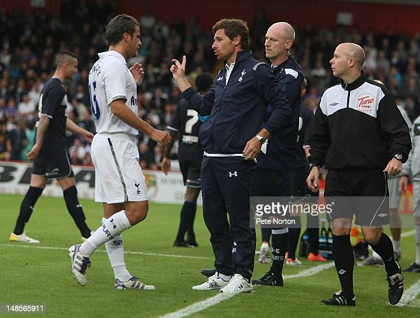 Tottenham Hotspur manager Andre Villas Boas talks to David Bentley during the Pre Season Friendly match between Stevenage and Tottenham Hotspur at...