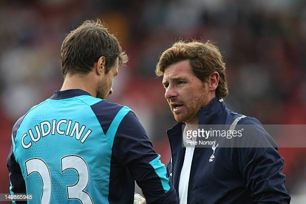 Tottenham Hotspur manager Andre VillasBoas talks to Carlo Cudicini prior to the sart of the second half during the preseason friendly match between...