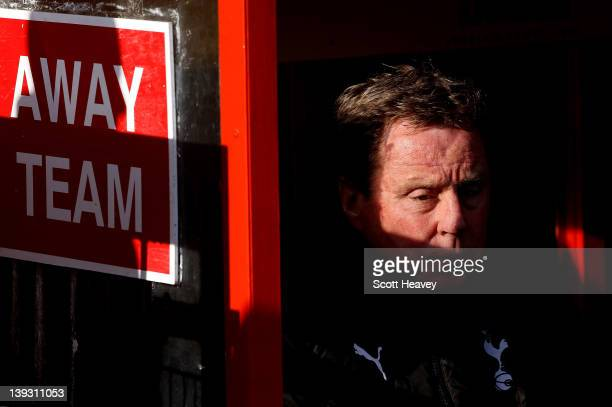 Tottenham Hotspur manager Harry Redknapp sits in the away dug-out prior to the FA Cup Fifth Round match between Stevenage and Tottenham Hotspur at...