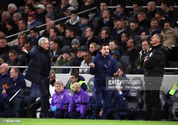 Tottenham Hotspur manager Jose Mourinho and assistant Joao Sacramento gesture towards fourth official Andre Marriner during the Premier League match...