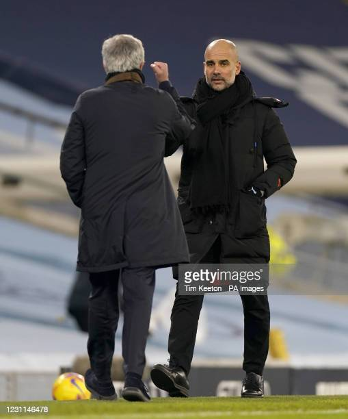 Tottenham Hotspur manager Jose Mourinho and Manchester City manager Pep Guardiola bump fists at the final whistle after the Premier League match at...