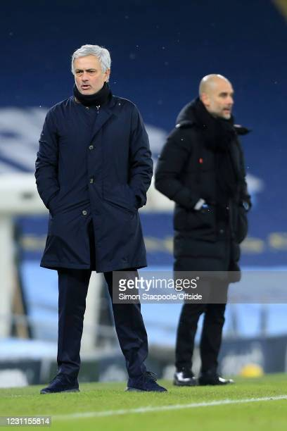 Tottenham Hotspur manager Jose Mourinho and Manchester City manager Pep Guardiola look on during the Premier League match between Manchester City and...