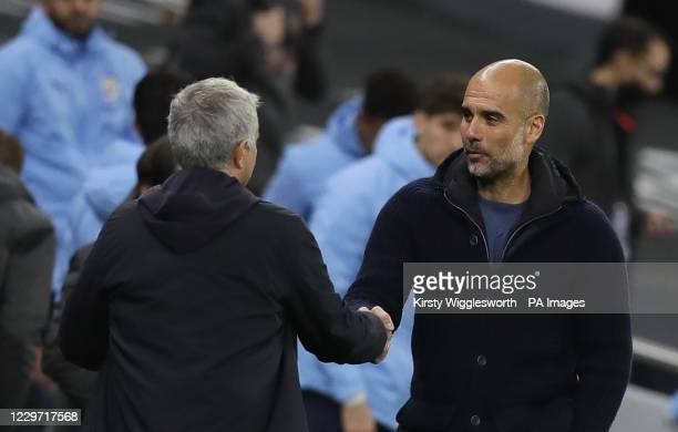 Tottenham Hotspur manager Jose Mourinho greets Manchester City manager Pep Guardiola after the final whistle during the Premier League match at the...