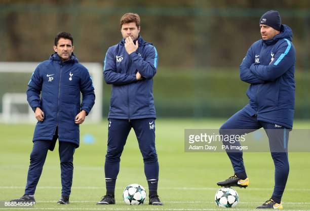 Tottenham Hotspur manager Mauricio Pochettino assistant Jesus Perez and coach Miguel D'Agostino during the training session at Enfield Training...