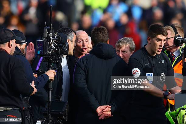 Tottenham Hotspur manager Mauricio Pochettino confronts referee Mike Dean at fulltime following the Premier League match between Burnley FC and...