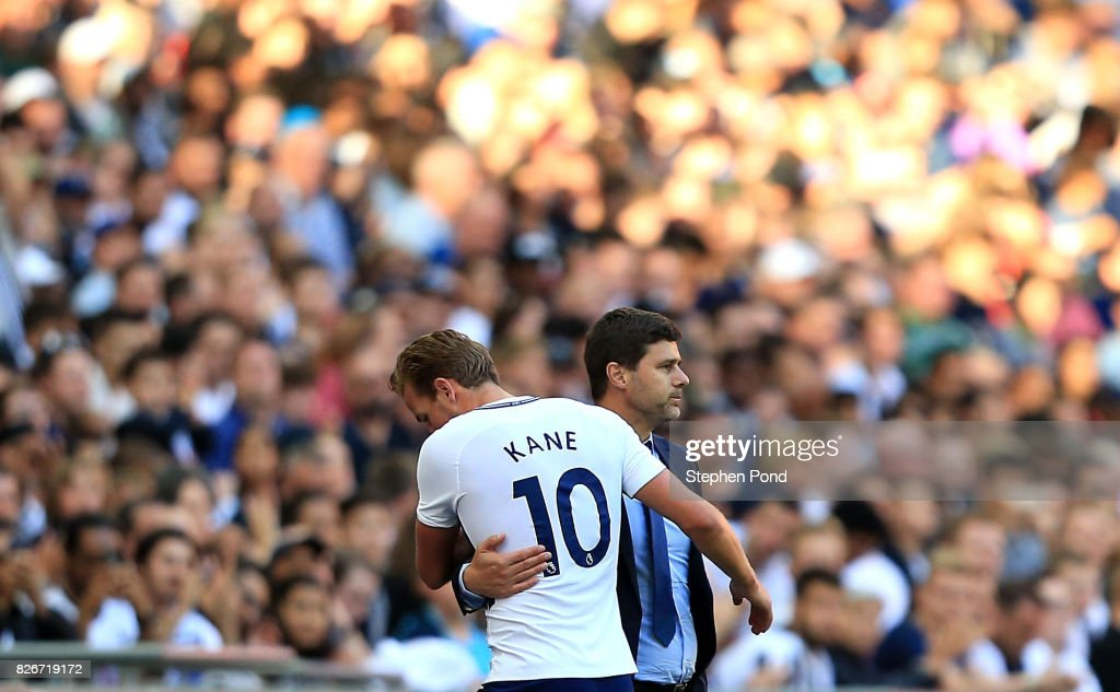 Tottenham Hotspur Manager Mauricio Pochettino embraces Harry Kane as he leaves the field during the Pre-Season Friendly match between Tottenham Hotspur and Juventus on August 5, 2017 in London, England.
