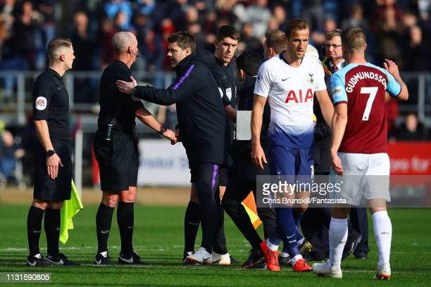 Tottenham Hotspur manager Mauricio Pochettino shakes hand with referee Mike Dean at fulltime following the Premier League match between Burnley FC...