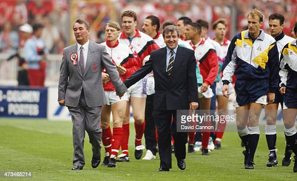 Tottenham Hotspur manager Terry Venables and Nottingham Forest manager Brian Clough lead the teams out hand in hand before the 1991 FA Cup Final...