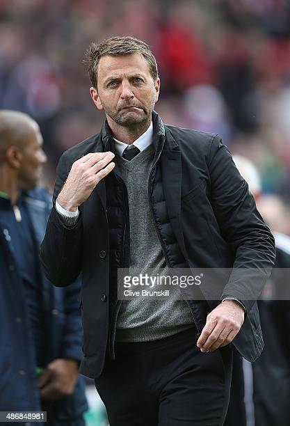 Tottenham Hotspur manager Tim Sherwood makes a gesture to his supporters during the Barclays Premier League match between Stoke City and Tottenham...
