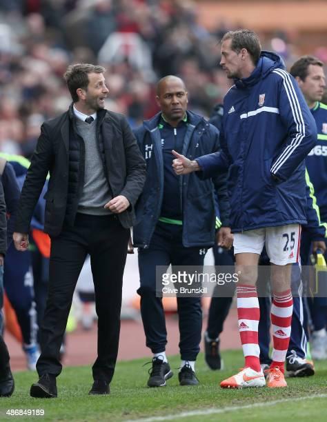 Tottenham Hotspur manager Tim Sherwood shares a joke with Peter Crouch of Stoke City during the Barclays Premier League match between Stoke City and...