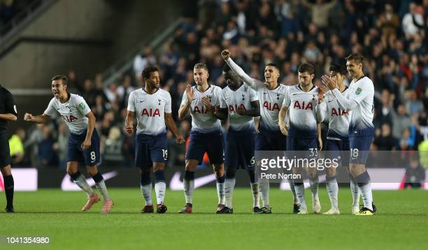 Tottenham Hotspur palyers celebrate after Dele Alli had scored the winning goal in a penalty shoot out during the Carabao Cup Third Round match...