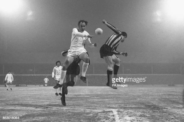 Tottenham Hotspur player Alan Gilzean jumps for the ball with Bradford City players Dennis Atkins and captain Tom Hallett during the FA Cup third...