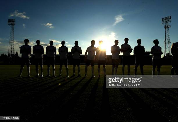 Tottenham Hotspur players applaud Josh Coulson of Cambridge United on his testimonial match during the pre season friendly match between Cambridge...